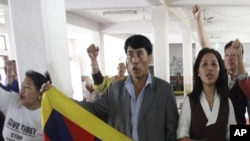 Tibetans living in Nepal shout slogans as they take part in a 24-hour hunger strike at the Tibetan Youth Club in Kathmandu April 18, 2011, to express solidarity with compatriots who were victims of a Chinese crackdown in Ngaba, Sichuan Province last month