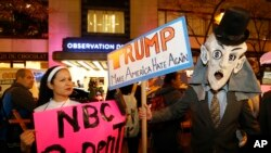 "Protesters opposed Republican presidential candidate Donald Trump demonstrate in front of NBC Studios Wednesday, Nov. 4. Trump hosted NBC's ""Saturday Night Live"" on Nov. 7."
