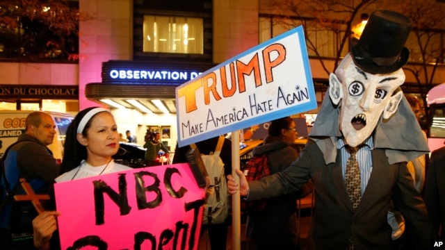 """Protesters opposed Republican presidential candidate Donald Trump demonstrate in front of NBC Studios Wednesday, Nov. 4. Trump hosted NBC's """"Saturday Night Live"""" on Nov. 7."""