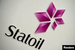 FILE - The company logo of Statoil is seen during a company results presentation in London, Britain, Feb. 6, 2015.