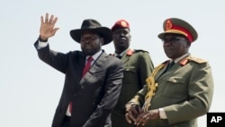 FILE - Then-SPLA Chief of Staff Paul Malong, right, is pictured with South Sudan President Salva Kiir during an independence day ceremony in Juba, South Sudan, July 9, 2015.