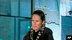 Aisha Gadhafi, umukobwa w'umutegetsi w'igihugu ca Libya, Moammar Gadhafi.