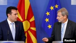 Macedonian Prime Minister Zoran Zaev and European Neighborhood Policy and Enlargement Negotiations Commissioner Johannes Hahn, right, address a joint news conference after their meeting at the EU Commission headquarters in Brussels, Belgium June 12, 2017.