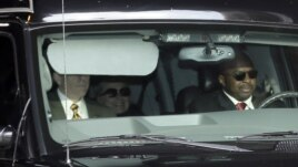 Secretary of State Hillary Clinton, center, is transported on the New York Presbyterian Hospital complex Wednesday, Jan. 2, 2013.