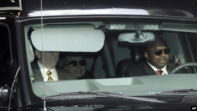 Secretary of State Hillary Clinton, center, is transported from the New York Presbyterian Hospital complex Wednesday, Jan. 2, 2013.