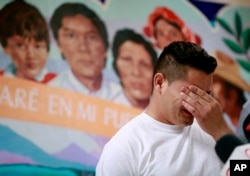 FILE - Christian, from Honduras, recounts his separation from his child at the border during a news conference at the Annunciation House, in El Paso, Texas, June 25, 2018.