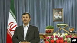 Iranian President Mahmoud Ahmadinejad takes part in a live TV program in Tehran on the occasion of the Iranian New Year, March 21, 2011