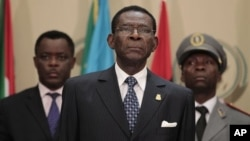 Equatorial Guinea President Teodoro Obiang (C) stands for the playing of the African Union anthem at the closing session of the 17th African Union Summit, at Sipopo Conference Center, outside Malabo, Equatorial Guinea, July 1, 2011.