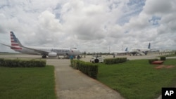 FILE - In this Friday, June 10, 2016, file photo, American Airlines and JetBlue Airways charter flights wait to depart from Havana's Jose Marti International Airport.