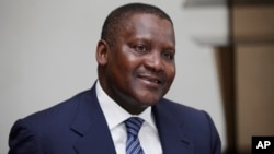 FILE - In this photo taken, Monday, Oct. 8, 2012 Nigerian billionaire businessman Aliko Dangote attends a global business environment meeting in Lagos, Nigeria.