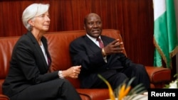 FILE - Ivorian Prime Minister Daniel Kablan Duncan (R) is seen meeting with IMF Managing Director Christine Lagarde.
