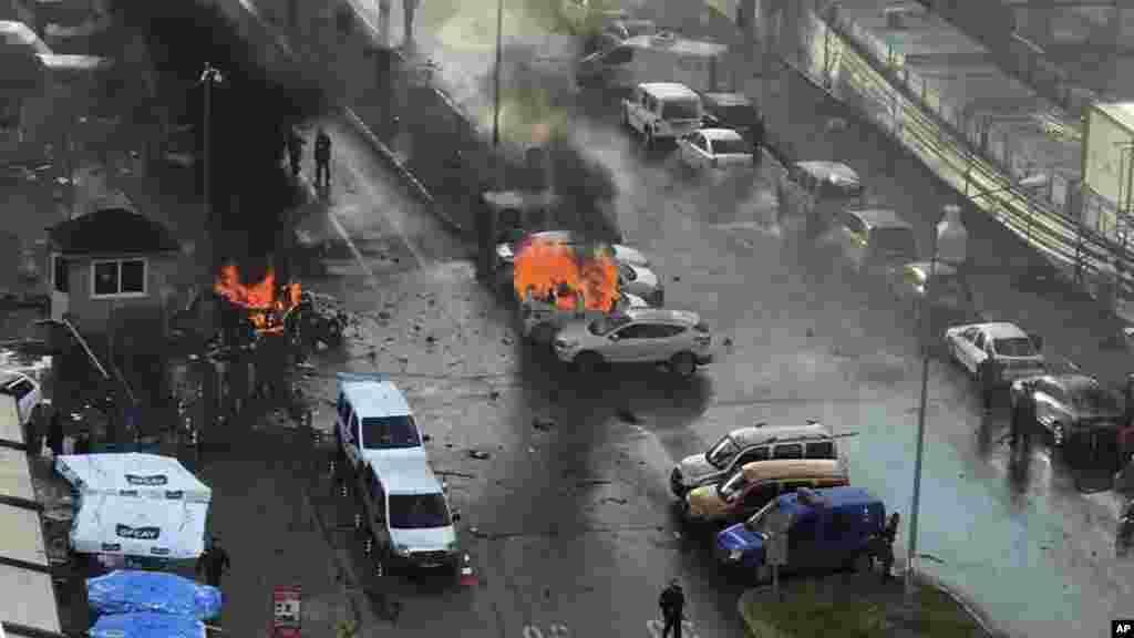 Cars burn after a car bomb explosion in Izmir, Turkey, Thursday, Jan. 5, 2017.