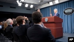 Defense Secretary Chuck Hagel speaks with reporters after announcing the U.S. will add 14 interceptors to a West Coast-based U.S.-based missile defense system, at the Pentagon, March 15, 2013.