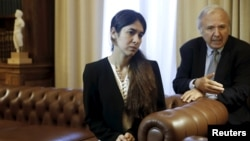 FILE - Nadia Murad Basee Taha, a 21-year-old Iraqi woman of the Yazidi faith who was abducted and held by the Islamic State for three months, meets with Greek President Prokopis Pavlopoulos (not pictured) at the Presidential Palace in Athens, Greece, Dec.