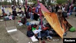 Central American migrants take a break from traveling toward the U.S., in Matias Romero, Oaxaca, Mexico, April 3, 2018.