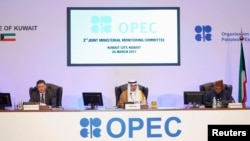 Kuwait Oil Minister Ali Al-Omair gives his opening speech during OPEC 2nd Joint Ministerial Monitoring Committee meeting as Russian Energy Minister Alexander Novak and OPEC Secretary-General Mohammad Barkindo attend the meeting in Kuwait City, Kuwait, March 26, 2017,