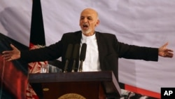 Afghan president-elect Ashraf Ghani Ahmadzai speaks in his first public appearance since being declared winner in the election runoff, in Kabul, Sept. 22, 2014.