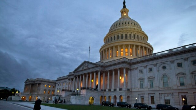 FILE - A view of the U.S. Capitol building is shown at dusk in Washington, October 2013.