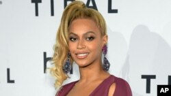 FILE - Beyonce arrives at TIDAL X: 1020 Amplified by HTC at the Barclays Center in New York.