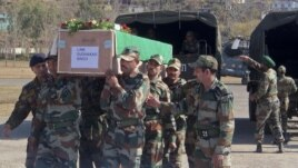 Indian Army soldiers carry a coffin containing the body of a colleague who was allegedly killed by Pakistani soldiers, Rajouri, India, January 9, 2013.