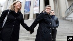 Sandy Stier, left, and Kris Perry of Berkeley, Calif., arrive at the National Archives in Washington, March 25, 2013, to view the U.S. Constitution, a day before their same-sex marriage case is argued before the Supreme Court.