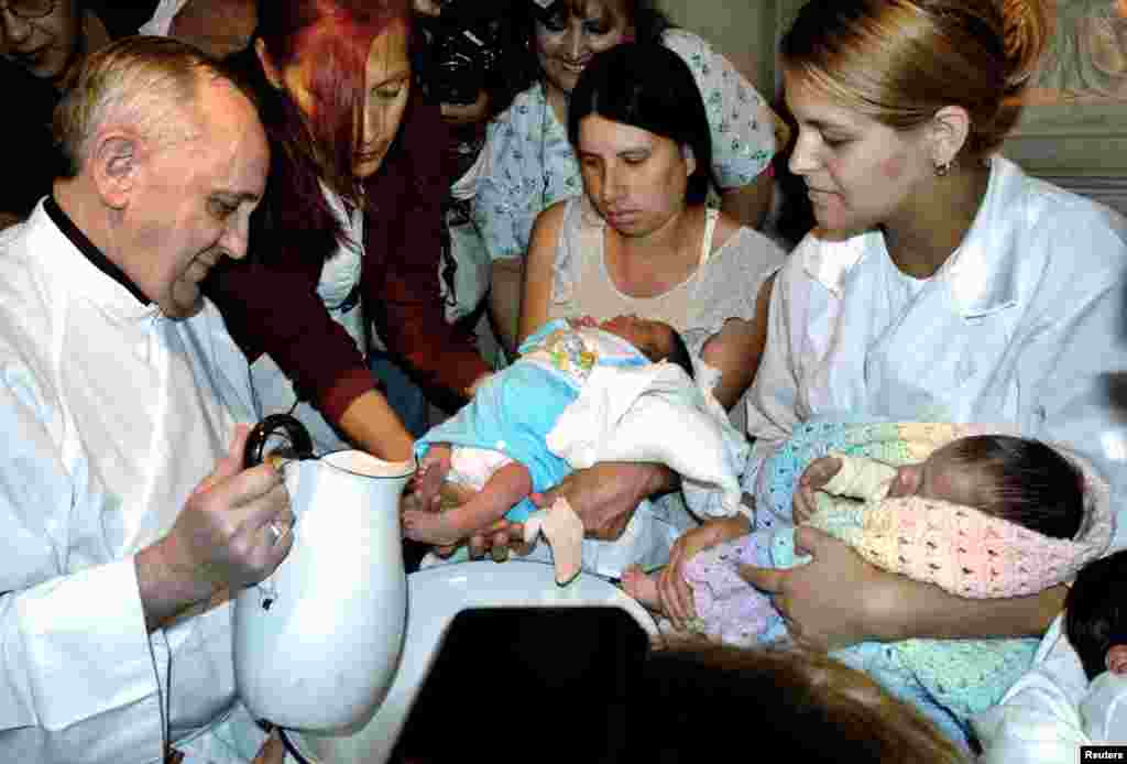 Then Argentine Cardinal Jorge Bergoglio washes the feet of two newly born children on Holy Thursday at the Buenos Aires' Sarda maternity hospital, March 24, 2005.
