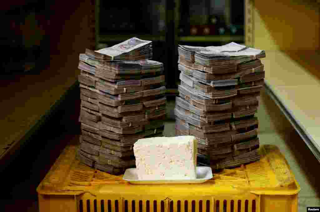 A kilogram of cheese is pictured next to 7,500,000 bolivars, the equivalent of $1.14.