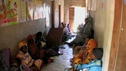 Women wait for treatment at a clinic in Kenya.