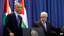 Presidente Barack Obama e o seu homólogo palestiniano Mahmoud Abbas durante uma conferência de imprensa na Margem Ocidental