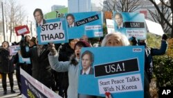 FILE - Protesters holding portraits of U.S. Deputy Secretary of State Tony Blinken denounce U.S. policy against North Korea at the Foreign Ministry in Seoul, South Korea, Feb. 9, 2015.