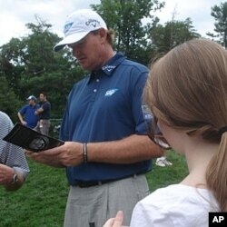 South African golfer Ernie Els signs an autograph at Congressional Country Club in Bethesda, Maryland, June 15, 2011