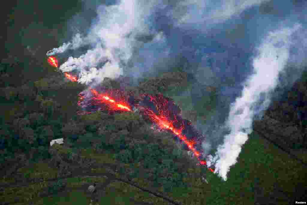 Lava erupts from a fissure east of the Leilani Estates subdivision during ongoing eruptions of the Kilauea Volcano in Hawaii, May 13, 2018.