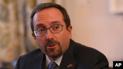 U.S. Ambassador John Bass says the political tensions are only benefiting terrorists and enemies of Afghanistan.