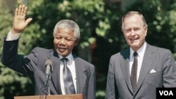 Nelson Mandela va katta Jorj Bush