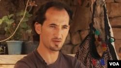 """""""利比亚阿马齐格青年大会""""创始人之一赛义德•汉希尔(视频截图)"""