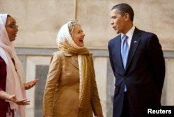 FILE - President Barack Obama and then-Secretary of State Hillary Clinton tour the Sultan Hassan Mosque in Cairo, June 4, 2009.