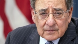 Defense Secretary Leon Panetta participates in a news conference at the Pentagon, Jan. 24, 2013, where he announced he is lifting a ban on women serving in combat.