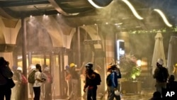 Protesters are engulfed in tear gas and sprayed by water canons at the entrance of the Divan Hotel, Istanbul, June 15, 2013.