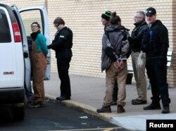 A woman is taken into police custody outside an anti-Dakota Access Pipeline protest at Kirkwood Mall in Bismarck, North Dakota, Nov. 25, 2016.