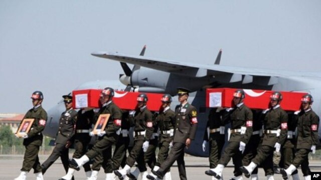 Turkish soldiers carrying the coffins of soldiers who were killed in an attack by members of the Kurdistan Workers' Party (PKK) during funerals in Van, August 18, 2011.
