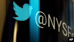 The Twitter logo appears on a phone post on the floor of the New York Stock Exchange, Oct. 27, 2016.