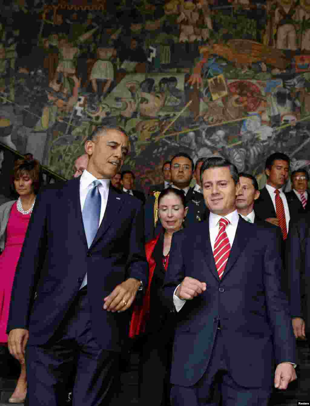 U.S. President Barack Obama and his Mexican counterpart Enrique Pena Nieto walk down a staircase at the National Palace in Mexico City, May 2, 2013.