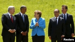 (L-R) Canadian Prime Minister Stephen Harper, U.S. President Barack Obama, German Chancellor Angela Merkel, French President Francois Hollande and British Prime Minister David Cameron take part in a family photo at the Group of Seven (G7) Summit in Kruen,