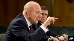Director of National Intelligence James Clapper (l) accompanied by DIA Director Lt. Gen. Michael T. Flynn, testifies on Capitol Hill, April 18, 2013.