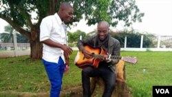 Emmanuel Bilashi (L) and Lindfort Ci are seen in Bamenda, Cameroon, Dec. 2, 2018. (M. Kindzeka/VOA)
