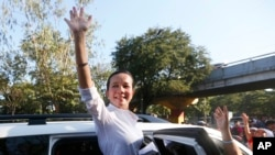 Philippine presidential candidate Sen. Grace Poe waves to supporters after addressing a rally to mark International Women's Day Tuesday, March 8, 2016 .
