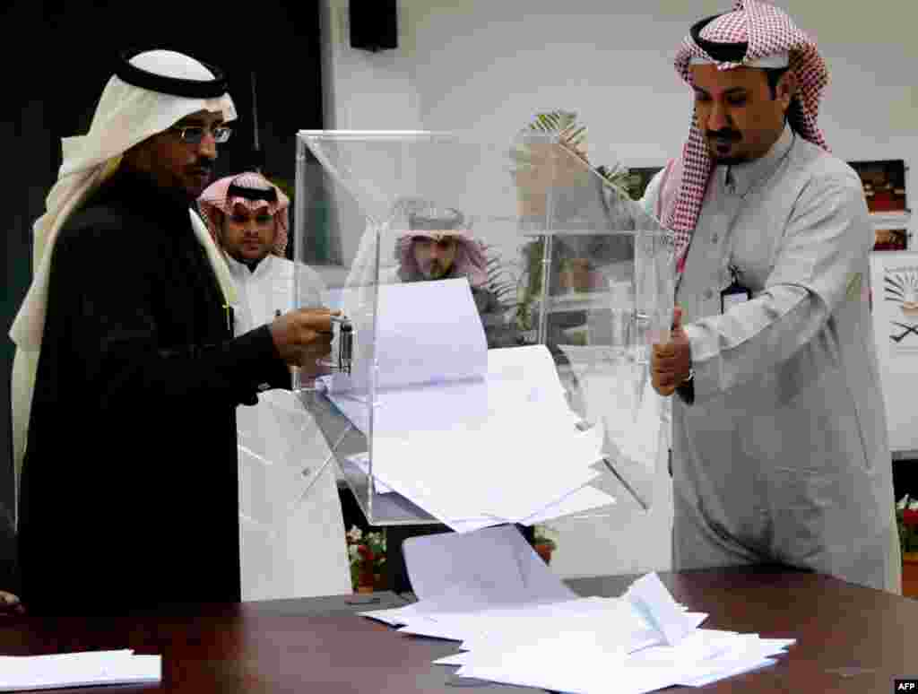 Saudi election officials prepare to count votes at the end of the municipal elections.