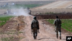 FILE - Turkish soldiers patrol near the border with Syria in southeastern Turkey, July 24, 2015.