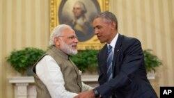 Le président Barack Obama et le premier ministre indien Narendra Modi se serrent la main à la fin d'une réunion à la Maison Blanche, à Washington, le 7 juin 2016.