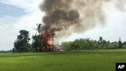 میانمر کی ریاست رخائن کے گاؤں گاؤدو زاراسے آگ کے شعلے بلند ہو رہے ہیں۔ روہنگیا مسلمان یہ گاؤں چھوڑ کر جاچکے ہیںَ۔ 7 ستمبر 2017